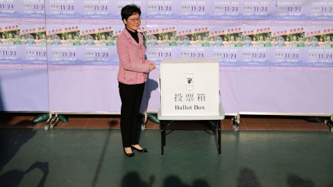 """Hong Kong Chief Executive Carrie Lam casts her ballot for the district council elections at a polling place, November 24. In a statement Monday, Lam said her government """"respects the election results."""""""