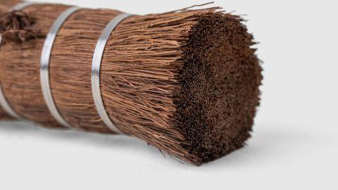 A $24 crumb brush made of windmill palm bark.