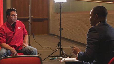 John Schnatter talks to an interviewer with WDRB.