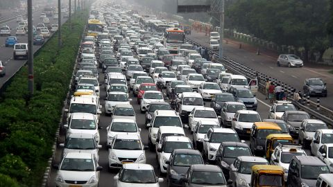 Traffic stretches back in Hero Honda chowk as waterlogging during monsoon downpours causes traffic jams in Gurgaon on July 29, 2016.  Thousands of Indians were left stranded overnight July 29, as major traffic gridlock paralysed roads leading to a key business city near New Delhi and authorities struggled to get the situation under control. / AFP / STRINGER        (Photo credit should read STRINGER/AFP via Getty Images)