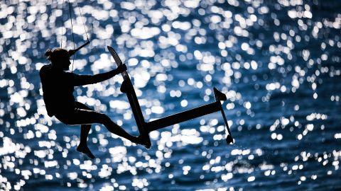 <strong> 7. Robert Hajduk. </strong>Athlete Blazej Ozog flies high on his foiling kiteboard off Tawila Island, Egypt.