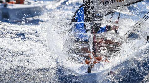 <strong>4. Martina Orsini.</strong> Spray creates the shape and sense of a shield protecting a young sailor on a O'pen Bic boat.