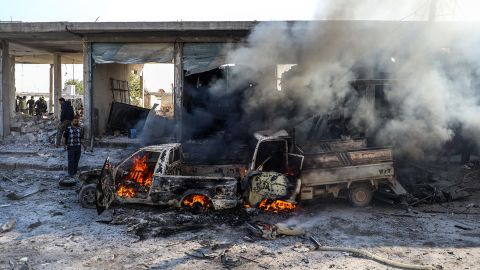 A car burns following a car bomb explosion in Tal Abyad, a city in northern Syria near the Turkey border, on Saturday, November 23.