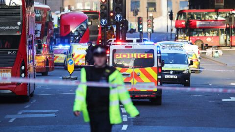 """Police and emergency services at the scene of an incident on London Bridge in central London following a police incident, Friday, Nov. 29, 2019. British police said Friday they were dealing with an incident on London Bridge, and witnesses have reported hearing gunshots.  The Metropolitan Police force tweeted that officers were """"in the early stages of dealing with an incident at London Bridge."""" (Gareth Fuller/PA via AP)"""