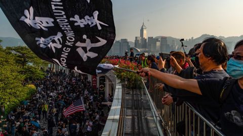 People take part in a march from Tsim Sha Tsui to Hung Hom in Hong Kong on December 1.