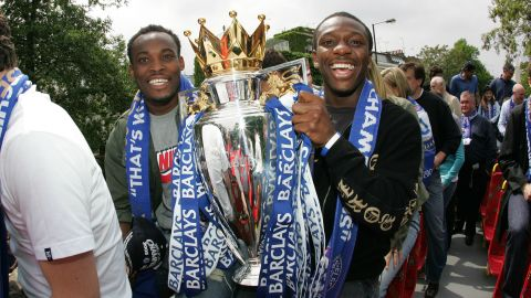 Chelsea's Michael Essien and Shaun Wright Phillips with the Premiership trophy.