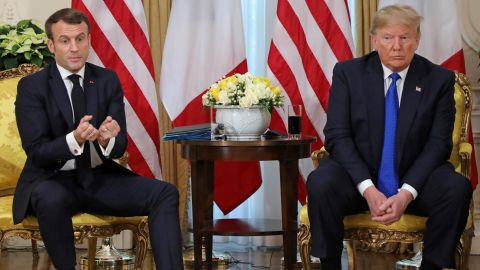 US President Donald Trump (R) France's President Emmanuel Macron react as they talk during their meeting at Winfield House, London on December 3, 2019. - NATO leaders gather Tuesday for a summit to mark the alliance's 70th anniversary but with leaders feuding and name-calling over money and strategy, the mood is far from festive. (Photo by ludovic MARIN / various sources / AFP) (Photo by LUDOVIC MARIN/AFP via Getty Images)