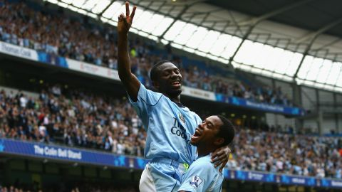 Wright-Phillips celebrates scoring a goal with teammate Robinho.