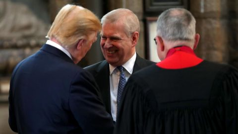 Prince Andrew, Duke of York smiles and shakes hands with US President Donald Trump during the visit to Westminster Abbey on June 03, 2019 in London, England.