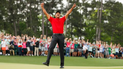 AUGUSTA, GEORGIA - APRIL 14: (Sequence frame 6 of 12) Tiger Woods of the United States celebrates after making his putt on the 18th green to win the Masters at Augusta National Golf Club on April 14, 2019 in Augusta, Georgia. (Photo by Kevin C. Cox/Getty Images)