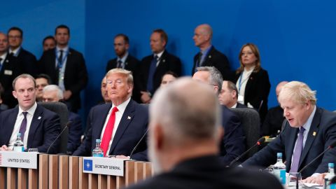 Britain's Foreign Secretary Dominic Raab (L) and US President Donald Trump (2L) listen as Britain's Prime Minister Boris Johnson (R) speaks during the plenary session of the NATO summit at the Grove hotel in Watford, northeast of London on December 4, 2019.