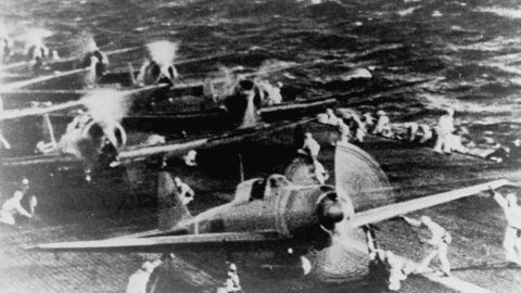 Crewmen of a Japanese aircraft carrier prepare fighter planes before the raid on Pearl Harbor.