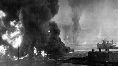Oil burns on the ocean's surface near the Naval Air Station.