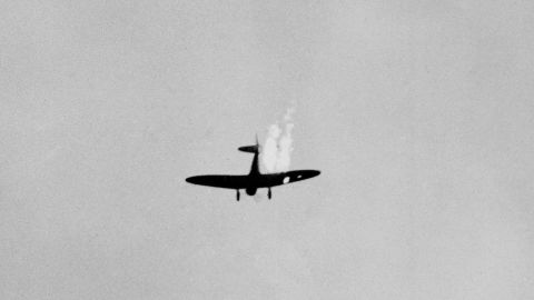 A Japanese plane plummets in flames after it was hit by US anti-aircraft.