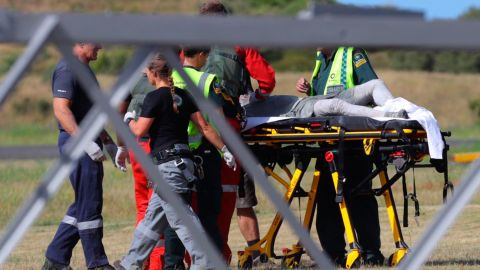 Emergency services attend to a person injured in the eruption, after arriving at the Whakatane Airfield.