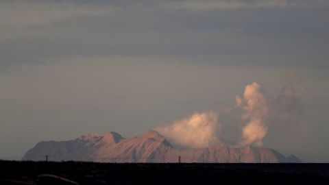 The eruption on White Island is viewed from the Bay of Plenty coastline on December 9.