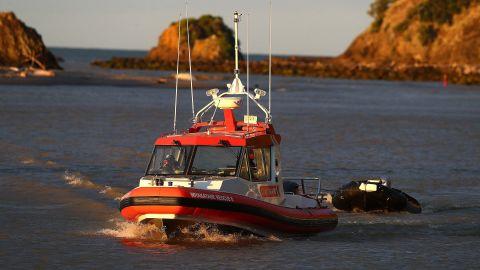 Coastguard rescue boats arrive at a marina near Whakatane on December 9.