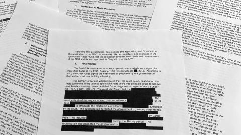 Pages from the report issued by the Department of Justice inspector general is photographed in Washington, Monday, Dec. 9, 2019. The report on the origins of the Russia probe found no evidence of political bias, despite performance failures.