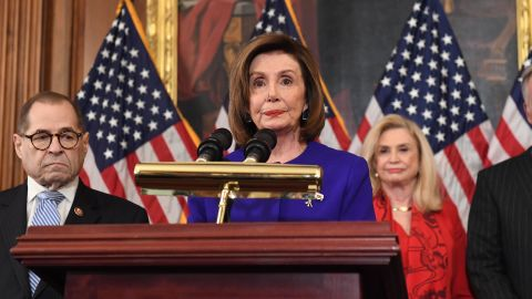 House Speaker Nancy Pelosi (D-CA) speaks next to House Judiciary Chairman Jerry Nadler(L), Democrat of New York, House Permanent Select Committee on Intelligence as they announce articles of impeachment for US President Donald Trump during a press conference at the US Capitol in Washington, DC, December 10, 2019.