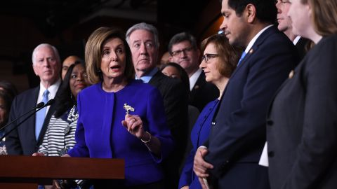 Speaker of the House Nancy Pelosi and House Ways and Means Committee Chairman Richard Neal(behind), Democrat of Massachusetts, speaks about the US - Mexico - Canada Agreement, known as the USMCA, on Capitol Hill in Washington, DC, December 10, 2019. - Officials from the US, Canada and Mexico will meet in Mexico on Tuesday for talks on a new continent-wide trade deal after President Donald Trump hinted that efforts to push the pact through the US Congress were close to success.