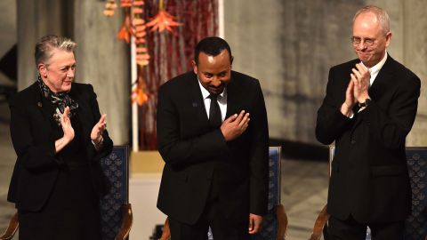 Ethiopian Prime Minister Abiy Ahmed, center, bows during the Nobel Peace Prize ceremony in Oslo, Norway, on Tuesday.