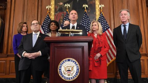 House Permanent Select Committee on Intelligence Chairman Adam Schiff (C) (D-CA), flanked by House Speaker Nancy Pelosi (L), House Judiciary Chairman Jerry Nadler (2nd L) (D-NY), House Foreign Affairs Committee Chairman Eliot Engel (R) (D-NY), House Financial Services Committee Chairwoman Maxine Waters (3rd L) (D-CA), House Committee on Oversight and Reform Chairwoman Carolyn Maloney (2nd R) (D-NY), speaks as Democrats announced articles of impeachment against US President Donald Trump during a press conference at the US Capitol in Washington, DC, December 10, 2019 listing abuse of power and obstruction of Congress.