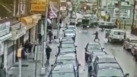 Surveillance video shows the shooters approaching the store.