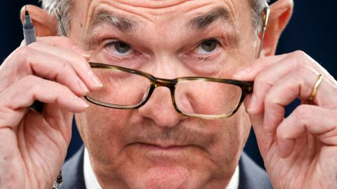 Federal Reserve Chair Jerome Powell removes his glasses as he listens to a question during a news conference after the Federal Open Market Committee meeting, Wednesday, Dec. 11, 2019, in Washington. The Federal Reserve is leaving its benchmark interest rate alone and signaling that it expects to keep low rates unchanged through next year. (AP Photo/Jacquelyn Martin)