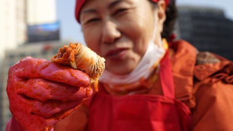 A woman makes kimchi, a traditional pungent vegetable dish, in Seoul, South Korea.