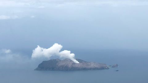 White smoke can still be seen billowing from the White Island volcano on December 12.