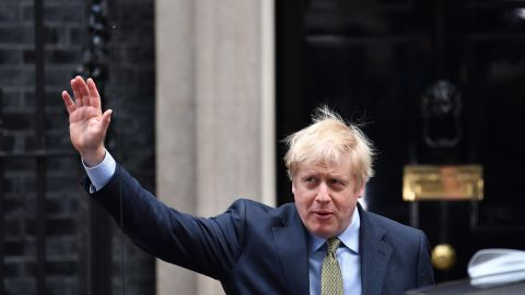 """Britain's Prime Minister and Conservative Party leader Boris Johnson waves as he leaves 10 Downing Street in central London on December 13, 2019, for an audience with Britain's Queen Elizabeth II at Buckingham Palace, where she will invite him to become Prime Minister and form a new government. - Conservative Prime Minister Boris Johnson on Friday hailed a political """"earthquake"""" in Britain after a thumping election victory which clears the way for the country to finally leave the EU next month after years of paralysing deadlock. (Photo by Ben STANSALL / AFP) (Photo by BEN STANSALL/AFP via Getty Images)"""