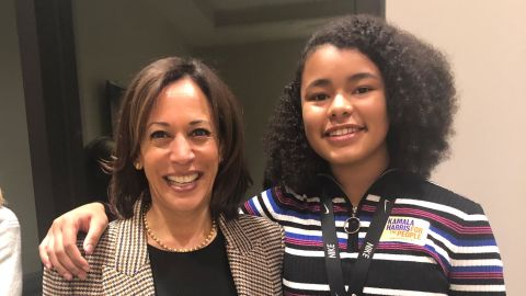 Sen. Kamala Harris poses with Paris Bond, class president of her Iowa middle school, at a private supporter meeting in November.