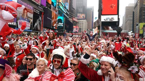 Revelers gather at the start of the SantaCon bar crawl at Father Duffy Square, a section of Times Square, on December 14, 2019.