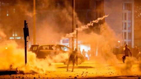 Lebanese demonstrators battle riot police in Beirut on Saturday.