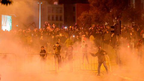 Lebanese demonstrators hurl rocks at riot police on Saturday night.