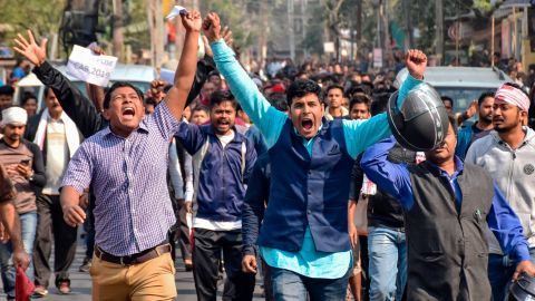 Demonstrators shout slogans during a protest against the government's Citizenship Amendment Bill (CAB) in Guwahati on December 12, 2019. - Indian police fired blanks on December 12 as thousands of protesters ignored a curfew in the north-east of the country, in a fresh day of demonstrations against contentious new citizenship legislation. (Photo by Biju BORO / AFP) (Photo by BIJU BORO/AFP via Getty Images)