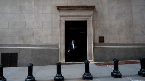 A man smokes a cigarette outside the New York Stock Exchange (NYSE) on April 8, 2019 in New York City. (Photo by Johannes EISELE / AFP)        (Photo credit should read JOHANNES EISELE/AFP via Getty Images)