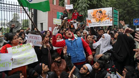 Indian students of the Jamia Millia Islamia University shout slogans during a protest, in New Delhi, India, Tuesday, Dec. 17, 2019. Indian student protests that turned into violent clashes with police galvanized opposition nationwide on Tuesday to a new law that provides a path to citizenship for non-Muslim migrants who entered the country illegally from several neighboring countries. (AP Photo/Altaf Qadri)