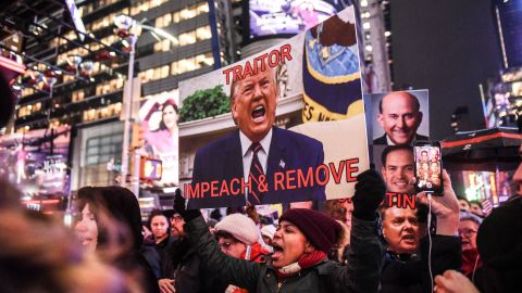 NEW YORK, NY - DECEMBER 17: People hold signs critical of U.S. President Donald Trump while participating in a protest in support of his potential impeachment on December 17, 2019 in New York, United States. The House of Representatives will be voting on articles of impeachment against President Trump tomorrow in Washington D.C. (Photo by Stephanie Keith/Getty Images)