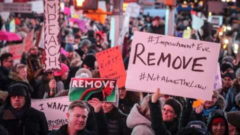 An anti-President Donald Trump crowd gather at a rally to protest and call for his impeachment.