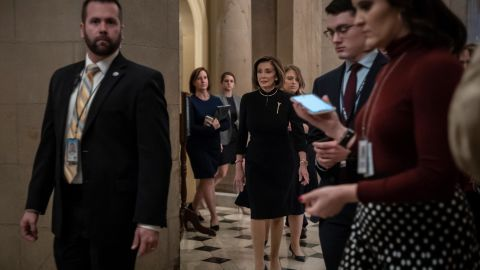 Pelosi walks from her office to the House chambers early on Wednesday.