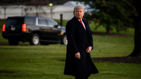 US President Donald Trump leaves the White House on his way to a campaign rally in Michigan on Wednesday, December 18.