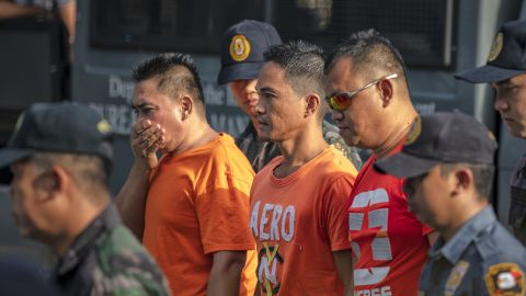 Suspects in the Maguindanao Massacre are escorted by policemen as they arrive at Camp Bagong Diwa, where a court will issue a verdict on the crime, on December 19, 2019 in Manila, Philippines.