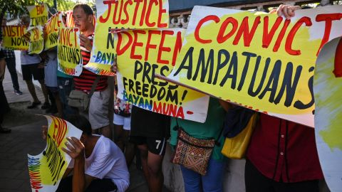 Supporters and journalists hold a rally in front of the gate of the capital command headquarters in Manila on December 19, 2019.