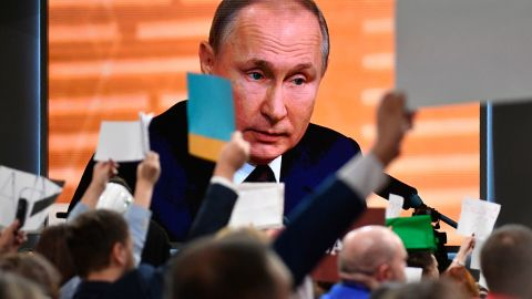 Russian President Vladimir Putin is seen on a large screen as he speaks during his annual press conference in Moscow on December 19, 2019. (Photo by Alexander NEMENOV / AFP) (Photo by ALEXANDER NEMENOV/AFP via Getty Images)