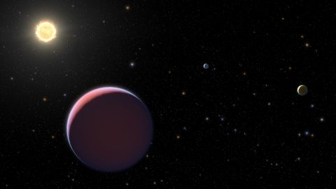 """This artist's illustration of the Kepler 51 system shows newly discovered super-puff exoplanets, which are also called """"cotton candy"""" exoplanets because they're so lightweight."""