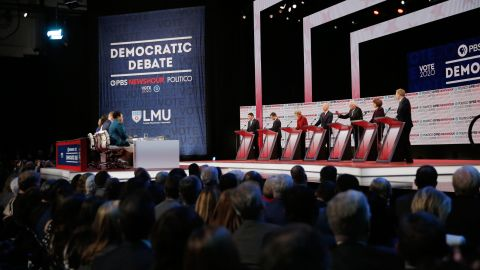 Presidential candidates Andrew Yang, Pete Buttigieg, Elizabeth Warren, Joe Biden, Bernie Sanders, Amy Klobuchar and Tom Steyer participate in the Democratic debate co-hosted by Politico and PBS Newshour in Los Angeles, California, on Thursday, December 19.