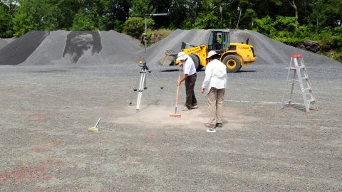 Researchers carefully clean and map the surface of the ancient forest discovered in Cairo, New York.