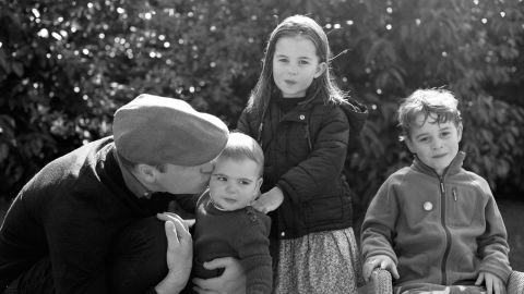 Prince William, Duke of Cambridge, kisses Prince Louis as they pose next to Princess Charlotte and Prince George in Norfolk in a handout photo taken by Catherine, Duchess of Cambridge, in 2019.
