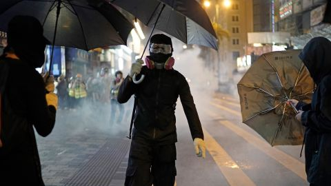 Tear gas is seen on the streets of Hong Kong on Christmas Eve.